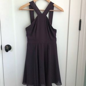 A plum purple fit and flare dress—lightly worn